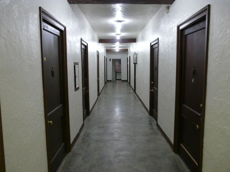 corridor: a passage into which several rooms or apartments ...