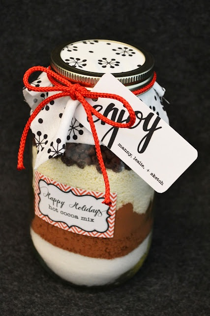 { Christmas gift ideas: homemade hot cocoa mix } Throw in some chocolate dipped peppermint sticks to stir cocoa.