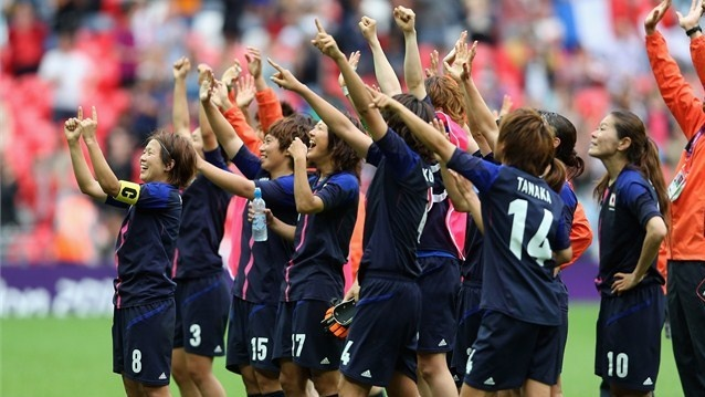 The Japan team thank the support during the women's Football semi-final match between France and Japan on Day 10 of the London 2012 Olympic Games at Wembley Stadium