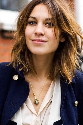 Style Icon Alexa Chung, in a lovely cream blouse, navy blazer and her messy, pretty look