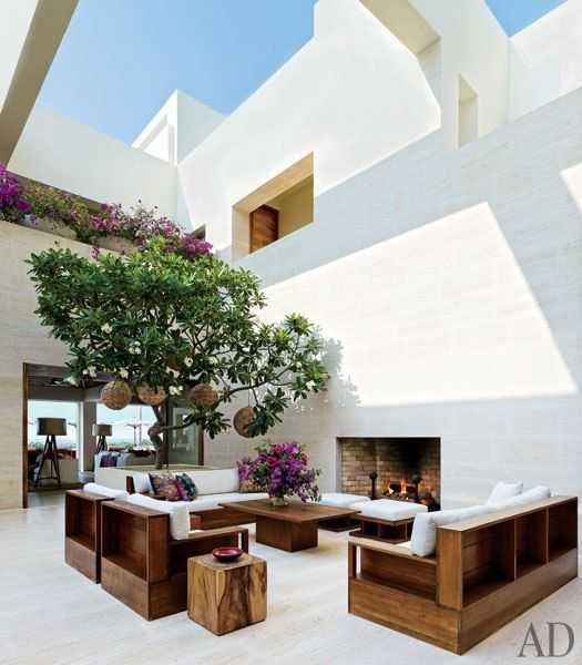 A frangipani tree lends a verdant note to Cindy Crawford and Rande Gerber's courtyard in Mexico
