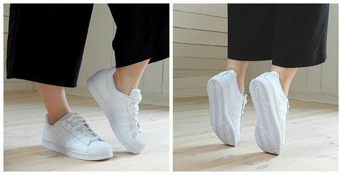 white crispy Adidas Allstars sneakers paired with culottes for a sporty everyday look