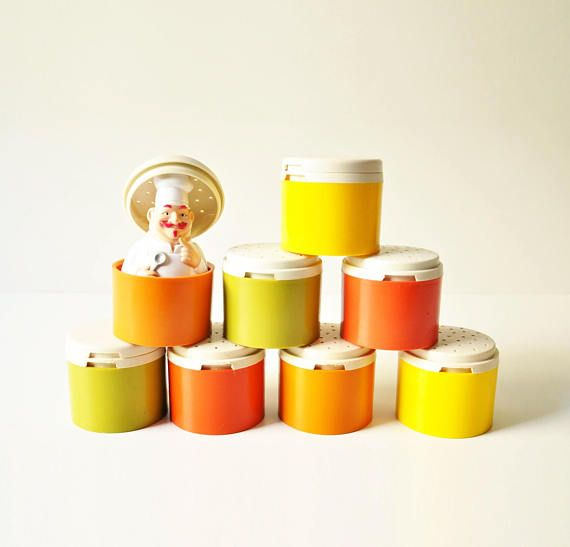 Colourful, retro set of eight Tupperware stackable spice containers, in yellow, green and orange colors, made in Greece, in the early 1970s.  In great vintage condition ready to be used in your kitchen! Also great for picnic or camping.  Each one measures approximately 5,5 cm in height.  - - - - - - - - - - - - - - - - - - - - - - - - - - - - - - - - - - - - - - - - - - - - - - - - - - - - - - -  Please take a closer look at all photos for the best idea of their condition.  Keep in mind that…