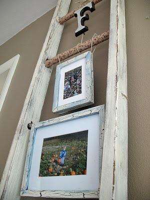use an older ladder to hang up photos, artwork, etc.