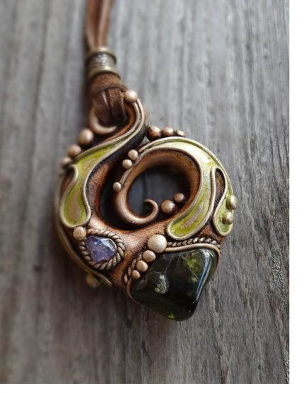 Tendrils and swirls with crystals on this durable clay pendant by Mila's Heart Art, as seen on the Polymer Arts blog, www.ThePolymerArts.com