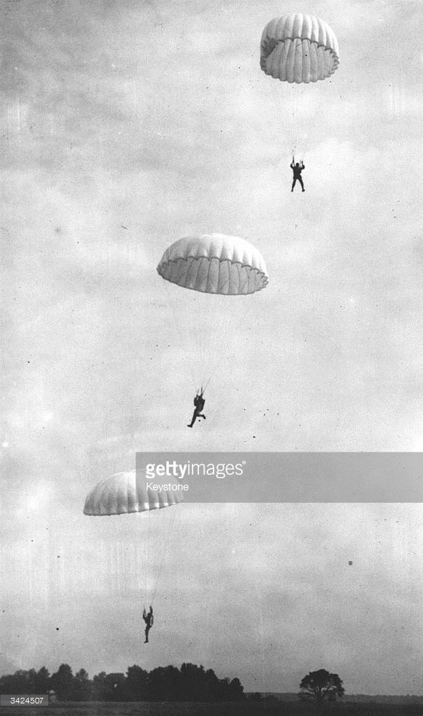 American Navy Marines parachuting down to an airport during a training exercise.