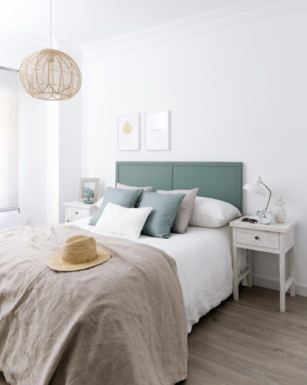 The use of rattan with earthy shades continues into the bedroom. We love the use of rattan light fittings that add intrigue throughout this stylish residence, including in the cool, calming bedroom. A gorgeous aqua headboard adds a burst of energy here, paired with complementary scatters and natural textures in neutral shades. A rustic bedside table painted in a distressed wooden finish completes this earthy, raw yet beautifully modern room.
