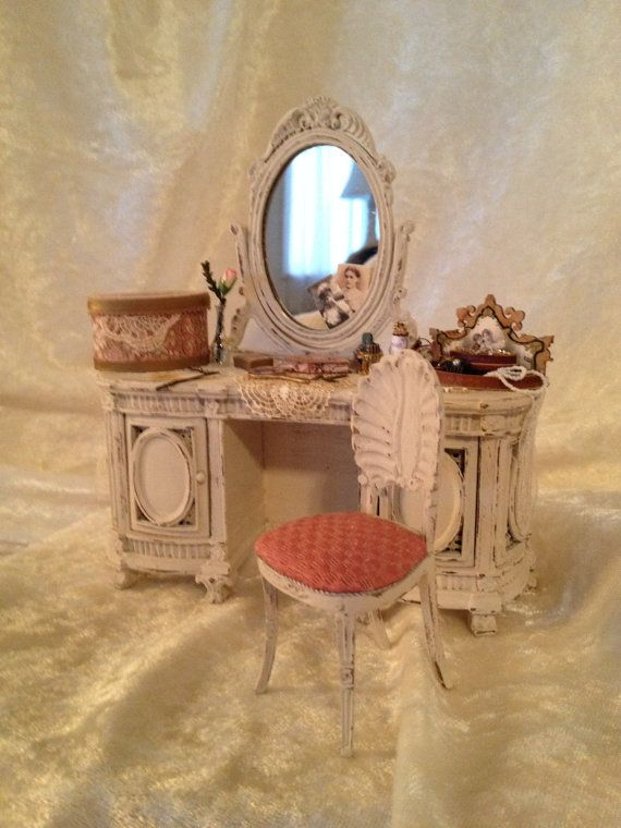 Shappy chic bespag vanity table.Off white distress look. Comes with chair and lots of accessories.Hat box,jewelry tray,hand mirror,bobbie pins,