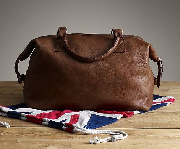 English Rugby #Bag - $450 / Crafted from burnished leather and fitted with antiqued black metal hardware, Restoration Hardware's rugby bag has the vintage styling, hand-distressing and rugged appeal that speaks to past and future game day glory. http://thegadgetflow.com/portfolio/english-rugby-bag/
