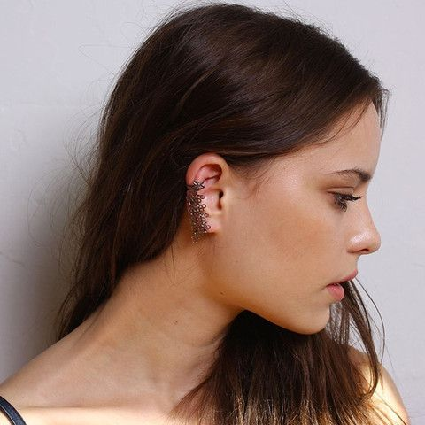 The Armor Cuff Earring By Boe is tough and beautiful. Two inches of armor cascade down your ear secured by the cuff at the top and your earring hole at the bottom.
