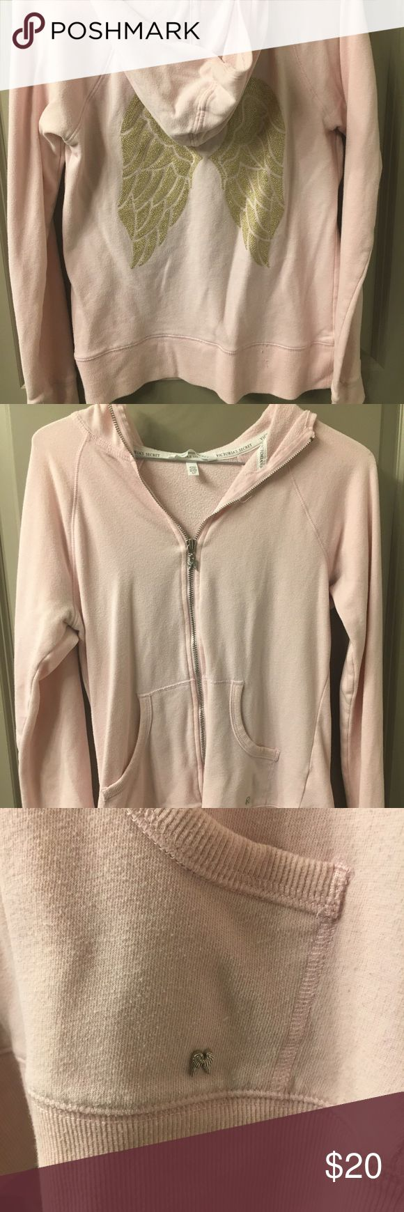 Victoria's Secret Gold Angel Wing Pink Zip Up No stains or tears. Pale Pink Zip up hooded sweatshirt with gold angel wings on the back Victoria's Secret Tops Sweatshirts & Hoodies