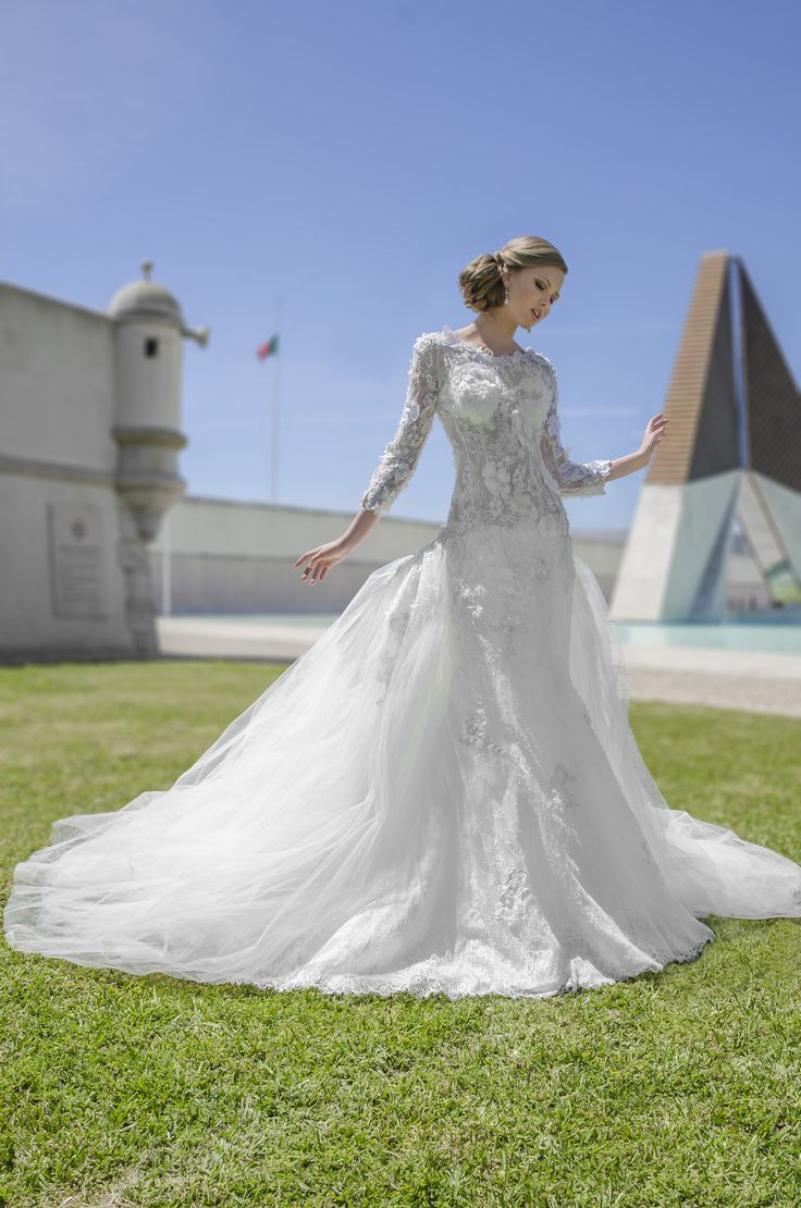 Wonderful couture dress with royal lace, beadings, long sleeves and detachable train.