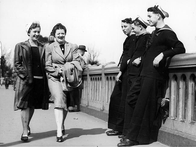 1940s: A city in war time = 1946: Women pass sailors on Princes Bridge. Picture: Herald Sun Image Library/ ARGUS