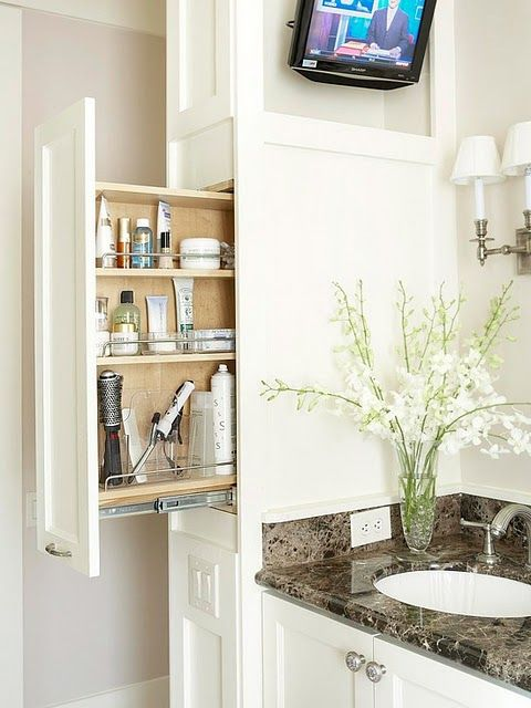 What a great way to have just what you need at your fingertips when getting ready in the morning. This kind of cabinetry is no longer just for spices and canned goods in the kitchen.