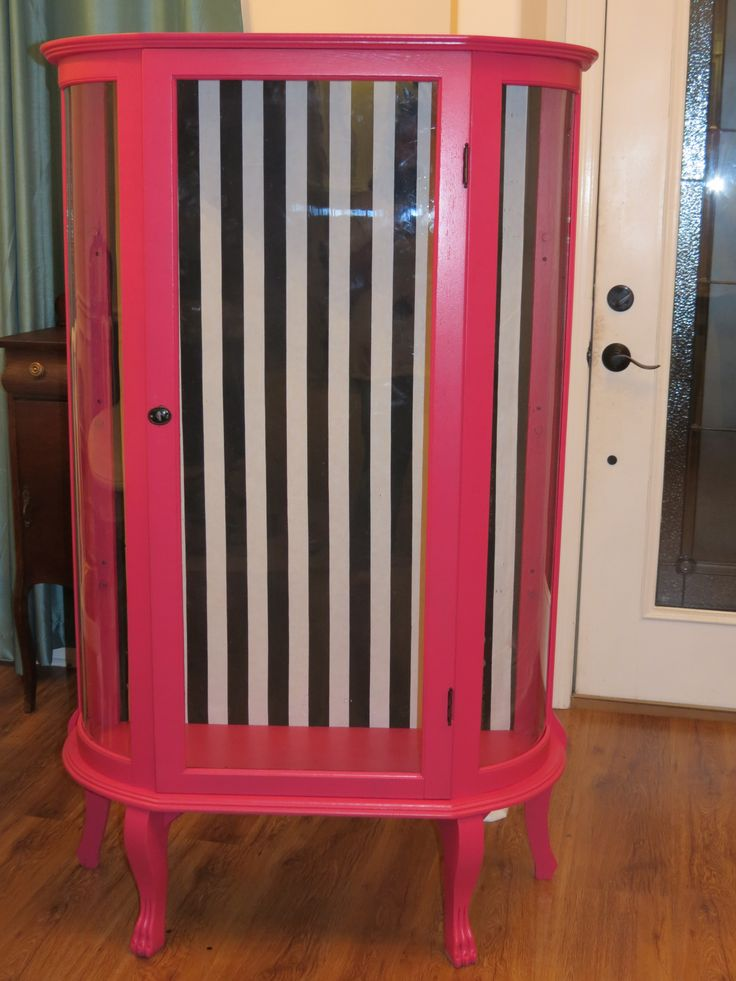 Fuschia curio cabinet with cabana stripes. This would be great in a closet to house shoes.