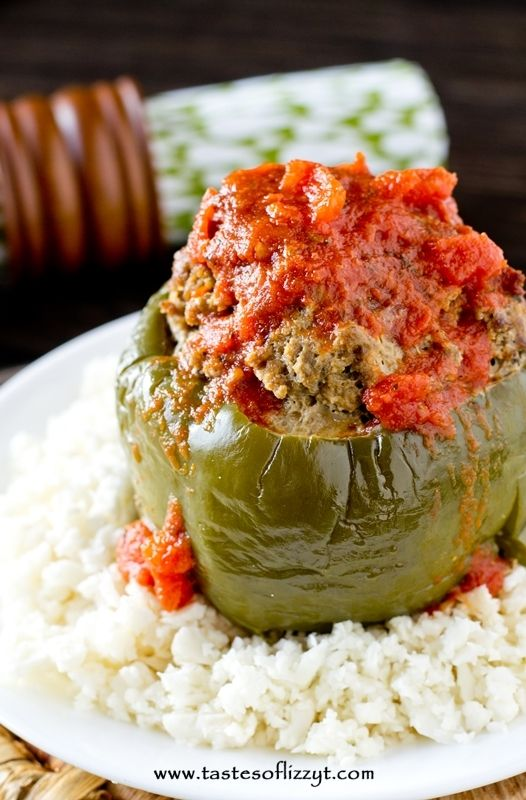 Paleo Stuffed Peppers filled with Italian seasoned ground sirloin and slow cooked to perfection. Serve with cauliflower rice .