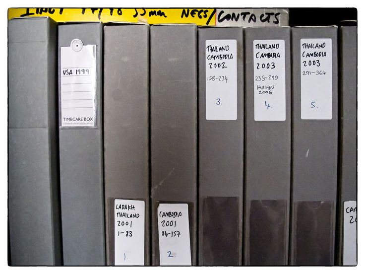 Archival boxes of 35mm and 120 film negatives and their corresponding contact sheets dating from 1999 to 2003.