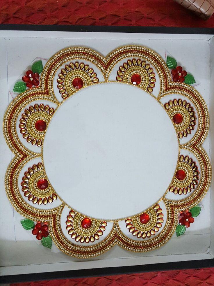 Kundan rangoli around plate or Diya (Samai)