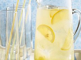 2  cups lemonade  1/2  cup blue orange-flavored liqueur (curaçao)  1  tablespoon sugar  1  teaspoon lime juice  2  cups coarsely crushed ice cubes