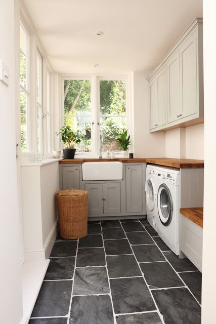 laundry room with light grey shaker cabinets
