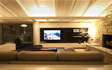 Super sleek modern TV setup.  I believe this setup is featured on IKEA hacker made from BESTA series products.
