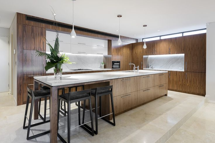 "Natural timber cabinetry and stone bench tops in Urbane Projects ""Natural Balance"" home."