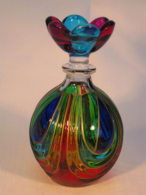 This is a beautiful Murano rainbow coloured perfume bottle. Both bottle and stopper are in excellent condition. It measures approx 12cm high x 7cm wide.