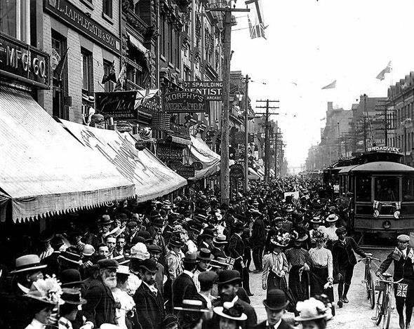 1900s: TCR car amidst Boer War celebrations on Yonge Street. Toronto.    Look at all the beautiful hats! Yonge St always gets me, I can't help but think of just how many people have walked the same path before me whenever I'm on it.
