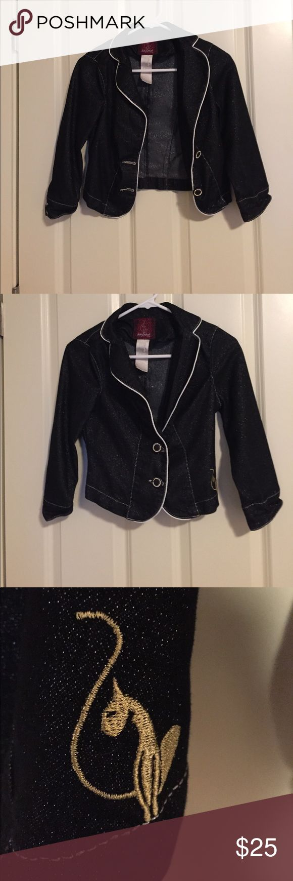 Sparkly Black Baby Phat Blazer Sparkly and stunning! Has a normal amount of loose threads from handling (worn maybe three times). All buttons and rhinestones in the buttons are present. Bundle to save even more! Let me know if you have any questions, happy poshing! ❤️ Baby Phat Jackets & Coats Blazers