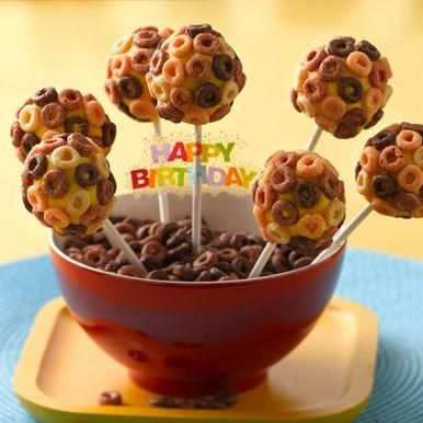 Here is a fun cake pop with a soft cake texture inside and decorated with Cheerios cereal on the outside.