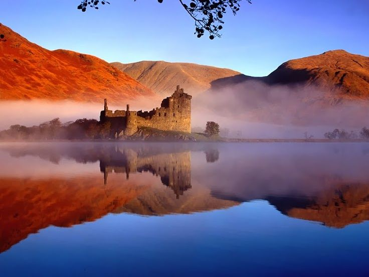 Stunning shot of Kilchurn Castle at the head of Loch Awe. #Scotland #explore. It's mother nature's colours; it's the surrounding colours