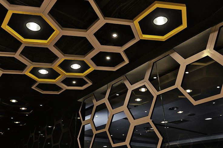irregular hexagons are distributed throughout the 'rice home' restaurant located in guangzhou city, china by hong kong company as design.