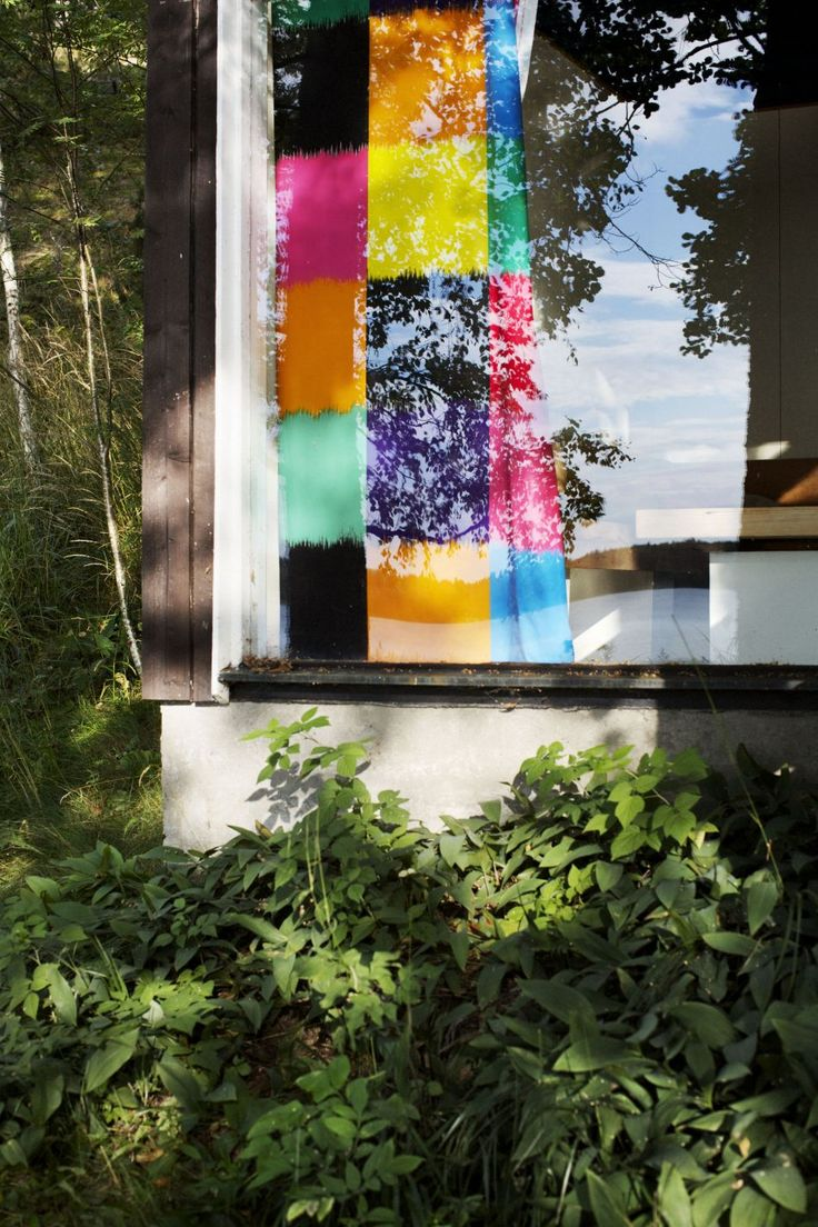 Despite this board's title, I've pinned it here because of the view IN through the window... to check out the very colorful curtains! (Marimekko)