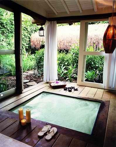 hot tub sanctuary - built in oblong hot tub in an enclosed deck