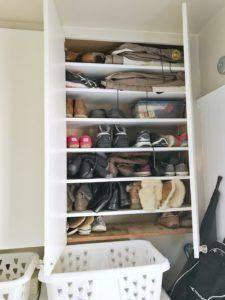 Living Large in a Small Space - Shoe Cabinet: Valerie has a shoe bar in her mudroom, but it isn't enough storage for the family of four. To compensate, Valerie goes vertical by utilizing the storage cabinets above the washer and dryer for shoe storage.