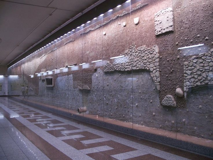 Ancient ruins on the wall of metro station..