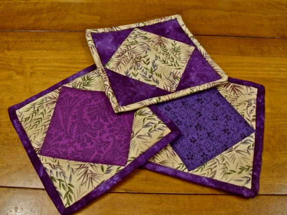 purple floral quilted potholders by StoneSoupImages on Etsy, $20.00