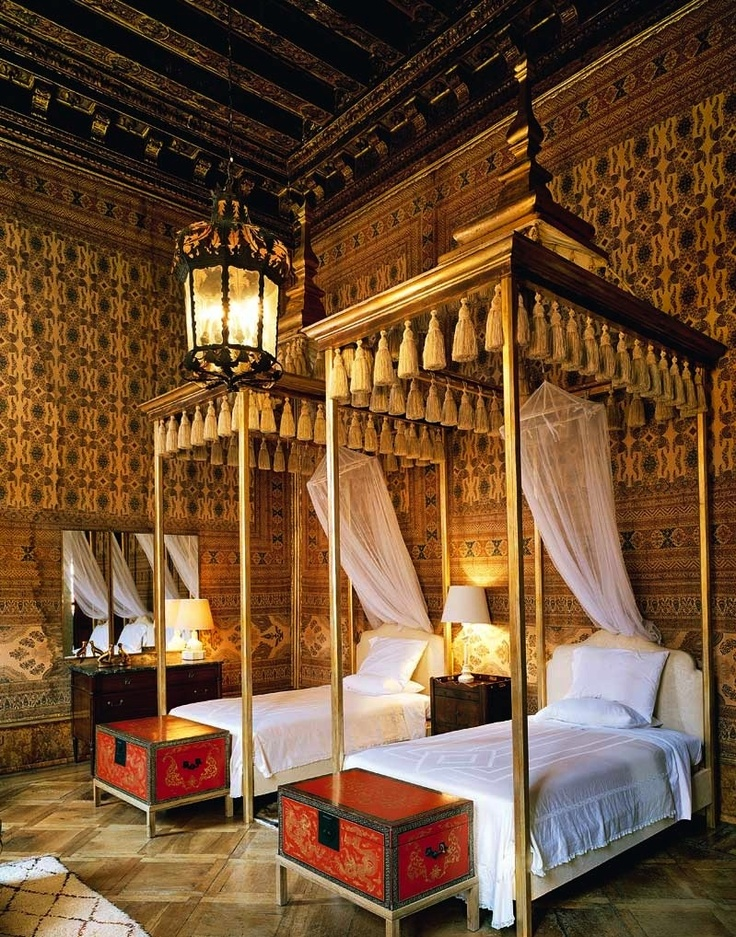 The guest bedroom at the Palazzo Brandolini decorated by Tony Duquette and Hutton Wilkinson.  The Indian printed cotton was installed in the room in the 60's by Renzo Mongiardino,  Duquette and Wilkinson designed the beds with their tassled canopies.