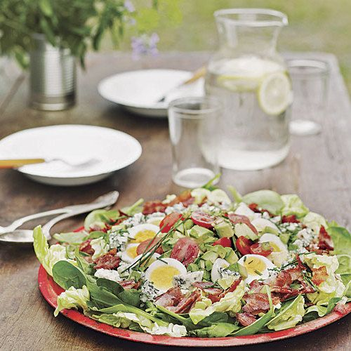 Fresh spinach isn't traditional in the classic Cobb salad, born at The Brown Derby restaurant in LA many decades ago, but it's a delicious addition. What's not to like about blue cheese, bacon, avocados, and tomatoes? With the hard-boiled eggs, you can call this supper. The salad can be served family-style, arranged in one big bowl, or you could make individual composed salads for a more formal dinner; in that case, dress the ingredients separately before arranging them.
