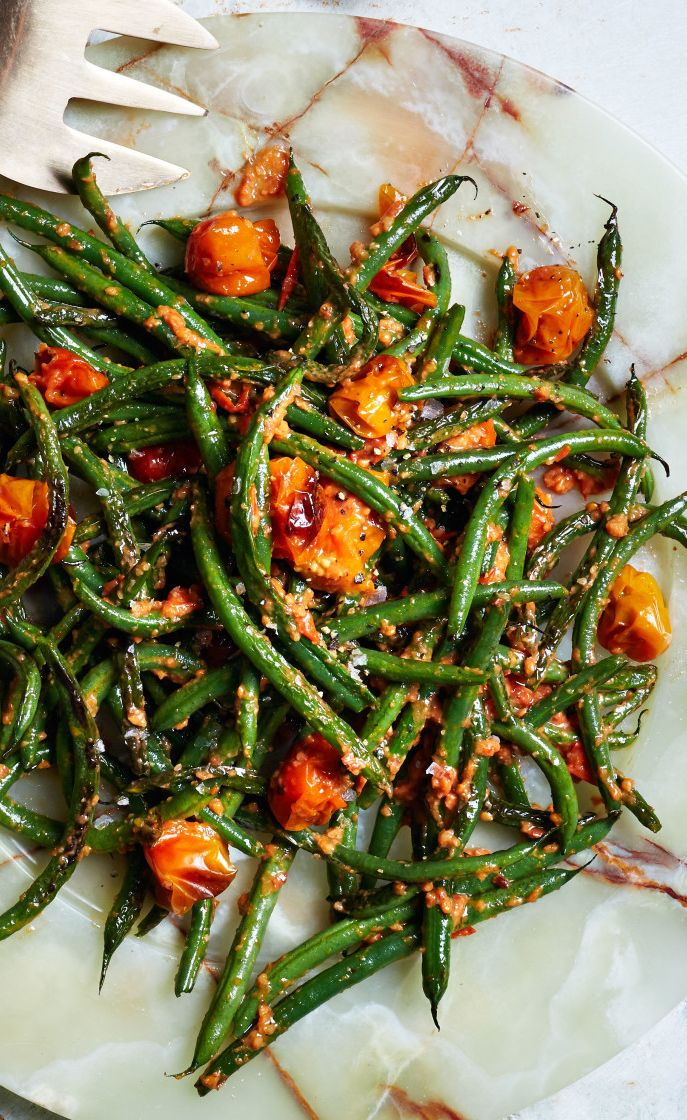 Blistered green beans with almonds and tomato pesto recipe: Your new favorite fall side dish.