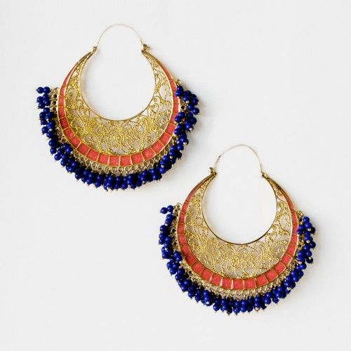 Moon Bali filigree hoop earrings- coral enamel and blue lapis beads details adds a fresh twist to your typical hoop earrings. Playful and ultimately glamorous, wear these dazzlers with a short cocktail dress. Handcrafted with coral enamel, blue lapis resin and 18k gold plated brass. Measures 6.8 cm long, 7.4 cm wide and weighs 40 grams a pair. As seen on Jennifer Hudson.