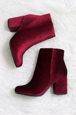 Velvet Vice Garnet Ankle Boot: This season´s perfect little ankle boot features a luxorious, garnet velvet! Has zip closure at side and a heel height of roughly 3