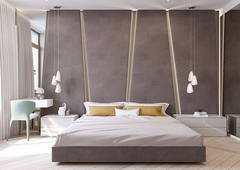The grey upholstered headboard in this modern bedroom almost takes up the entire wall. The angular panels have hidden lighting between them giving the bedroom a soft glow.
