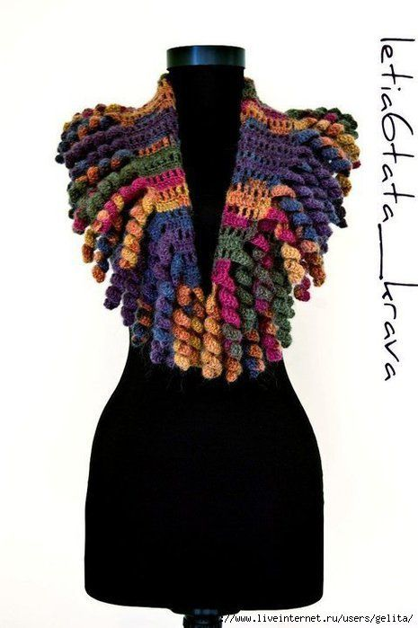 Another adorable Curlicue Scarf on Russian Site. I like the use of a variegated yarn for this exuberant design.