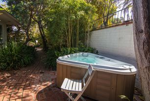 Traditional Hot Tub with exterior brick floors, Fence