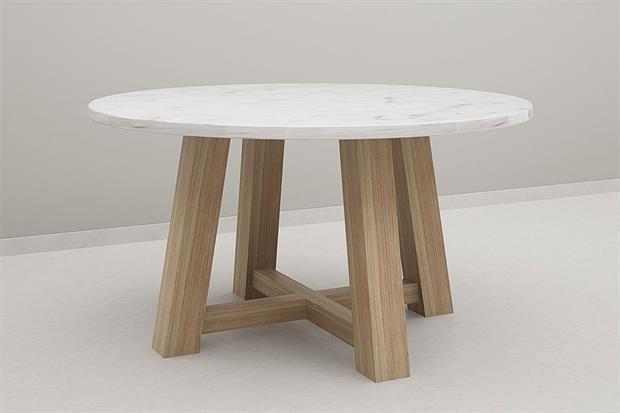 Mesas redondas: 10 modelos para equipar tu comedor  Con tapa de cemento alisado gris y patas en madera maciza de Petiribí ($17140
