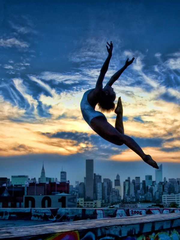Dance. Ballet leap above NYC. Love this.