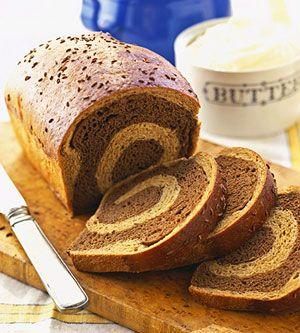 With swirls of dark pumpernickel and golden rye, this yeast bread makes eye-catching sandwiches.