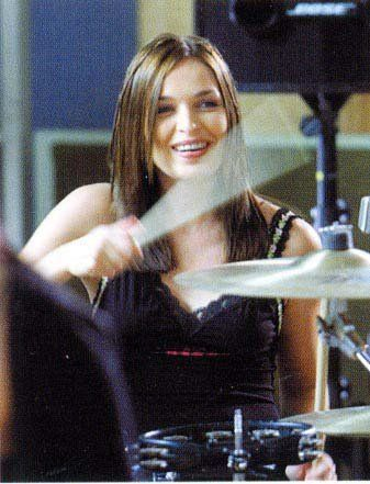 Caroline Corr (March 17, 1973) Irish drummer, percussion, keyboardplayer and tambourineplayer, known from the band 'The Corrs'.
