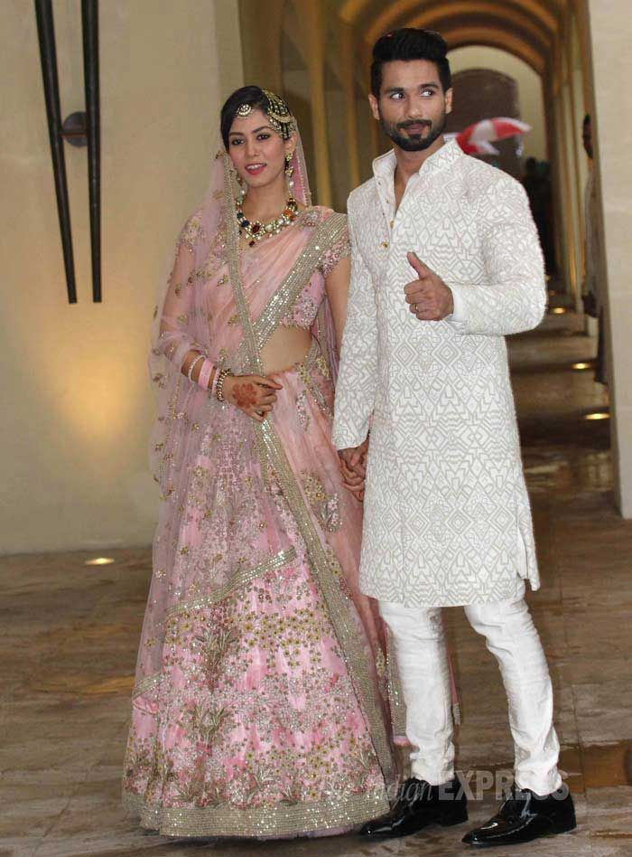Mira in a delicate rose-hued Anamika Khanna lehenga with shimmer and shine that complimented Shahid's cream-white sherwani suit. She sported an elaborate Navratna neckpiece and earrings set, and teamed her look with a 'maang-tika' and a 'jhoomar' on the side of her head.